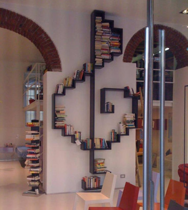 "Here's a bookshelf for those of you who are musically inclined. For more bookshelf inspiration view our ""Bookshelves"" album on our site at http://theownerbuildernetwork.co/ideas-for-your-rooms/home-storage-gallery/bookshelves/ Feeling inspired?"