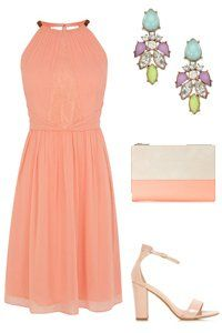 orange wedding outfit for a guest | Look effortlessly chic in an elegant halter neck dress. Statement ...