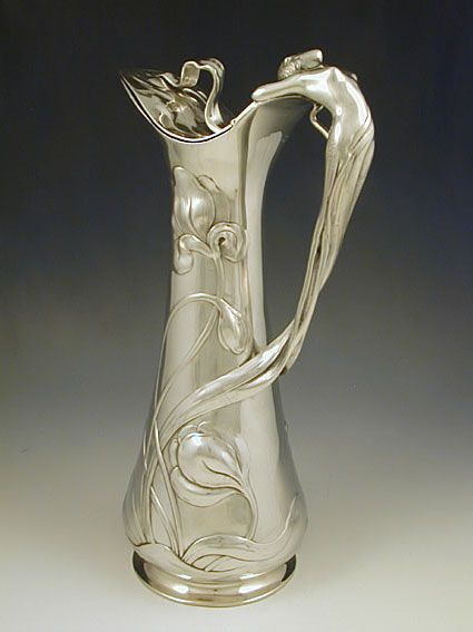 Manufacturer WMF ~ Polished pewter flagon with a handle in the form of a figural Art Nouveau mermaid ~ Germany ~ 1906