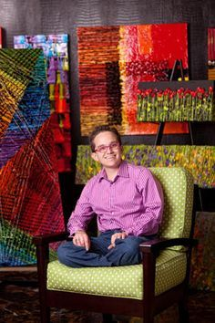 Jeff Hanson  ​A blind artist's altruistic vision - CBS News (Image: Hanson sitting on a bright green chair, his vibrant/ high-contrast/ floral paintings behind him)