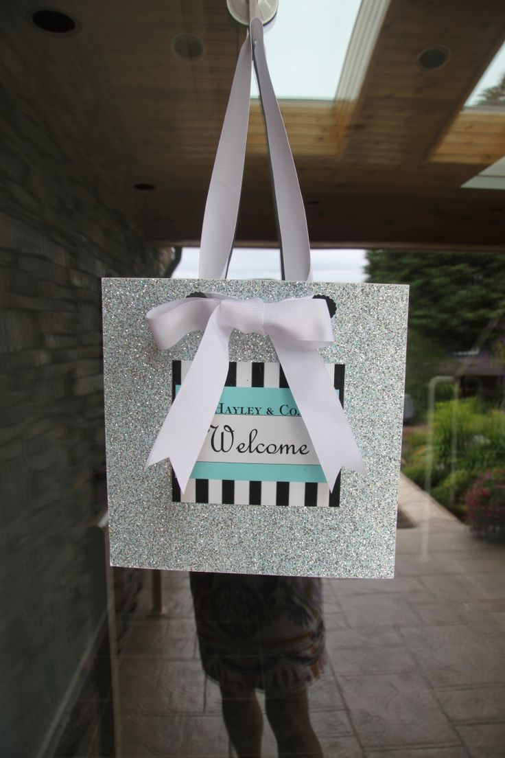 Scrapbook ideas with ribbon - Tiffany S Bridal Shower Door Sign Made With Sparkly Scrapbook Paper And Large Ribbon