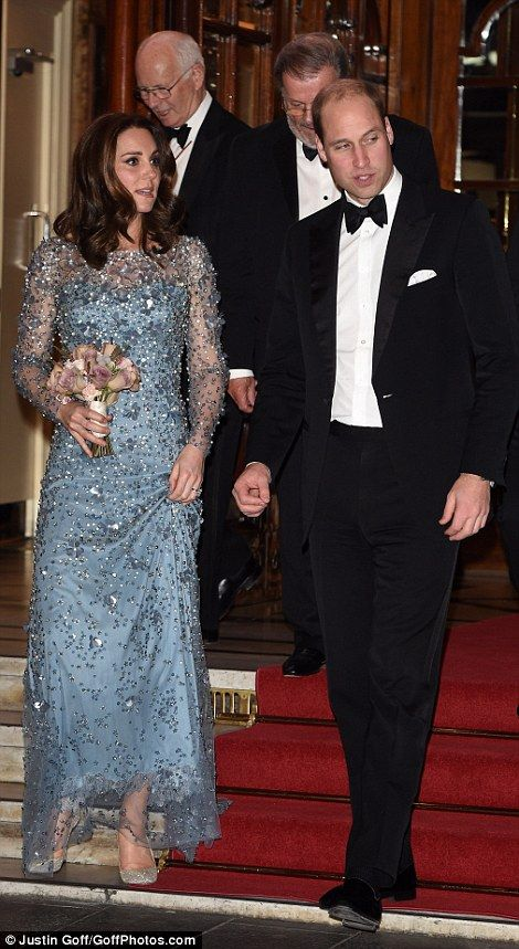 Perfect couple: Kate and Will descend the stairs, lined with a red carpet at the London Pa...