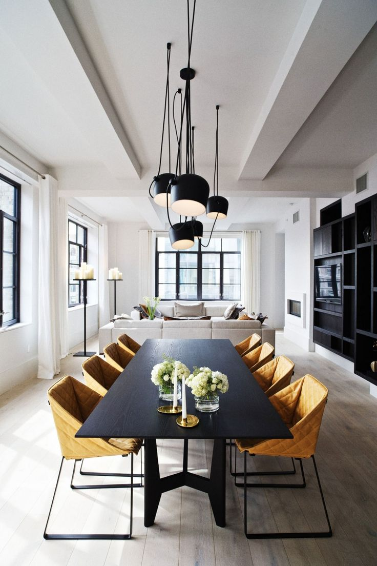 Nice combination of leather chairs, big black wooden table and loose style light fixture!