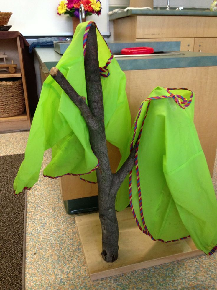 Water jacket hanger made from a beech branch screwed to a pine board.  Provides a place for the jackets to drip dry.