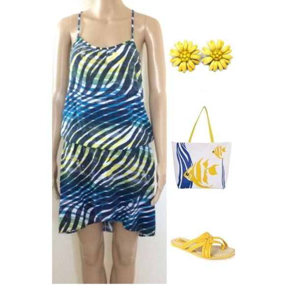 HangTen Racer Back Dress A tulip-design skirt and a racer back complete this fun casual look. With the tropical streams of prints, this is what gives the dress it's unique character. Elastic waistline. Pair with sandals or slides and you have an effortlessy sexy look. You are sure to beat the heat in this super cute racer back dress. Hangten Dresses