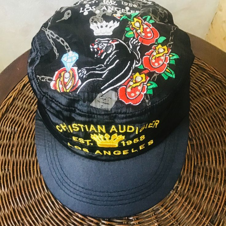 Black silk satin cap. Legendary designer cap with embroidery on tattoo Christian Audigier . Ed hardy