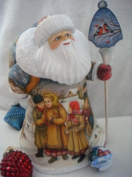 beautiful hand painted scenes all around the cloak and wondrous smiling face on this RUSSIAN SANTA CLAUS