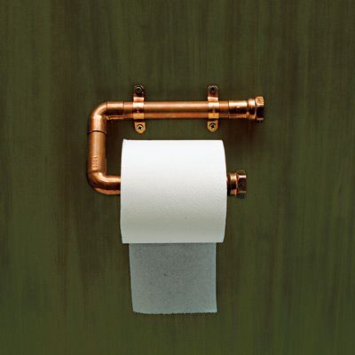 Copper gleams as a support for toilet paper. TOH technical editor Mark Powers made the one above out of tubing and various fittings. To keep its sheen, spray it with lacquer.