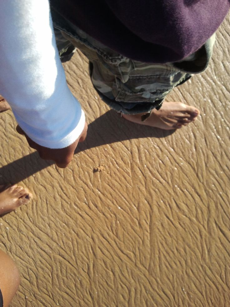 Our feet in the sea sand