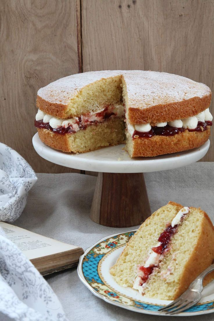A light and airy Victoria Sponge Cake which is filled with strawberry jam and a rich, creamy, buttercream! A real British classic.