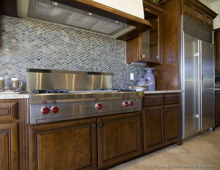 Idea of the Day: Deep & Luxurious, Dark Walnut-Colored Kitchen with mosaic  tile backsplash.