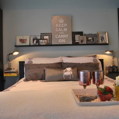 love the floating books instead of bedside tables + shelf over bed!