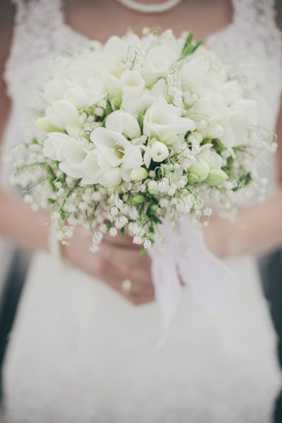 Bridal bouquet. Freesia and lily of the valley.