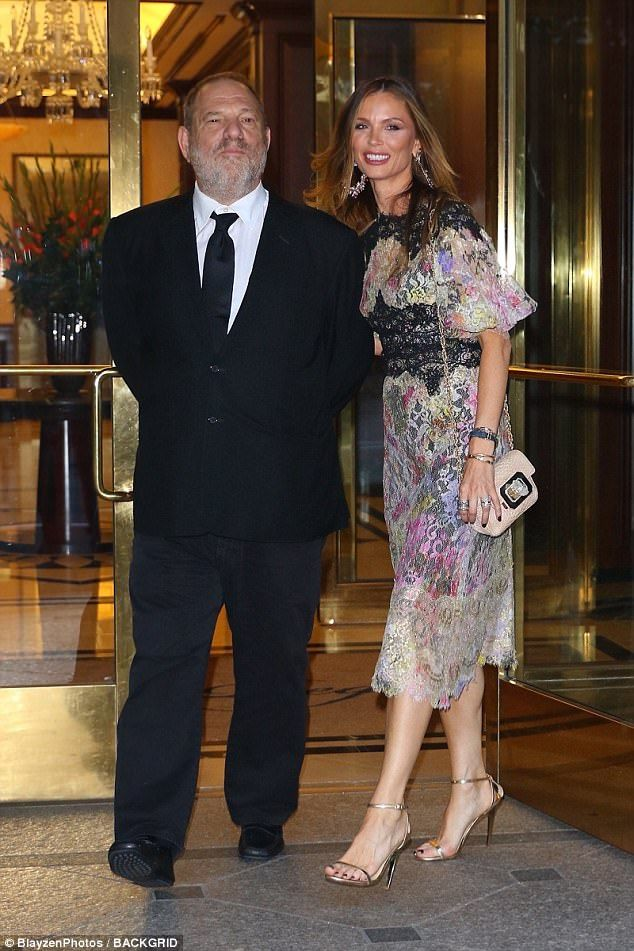 Power couple: Movie producer Harvey Weinstein wore a dark suit and tie while his wife Georgina Chapman was dressed in a pretty colorful frock and shiny gold stiletto sandals