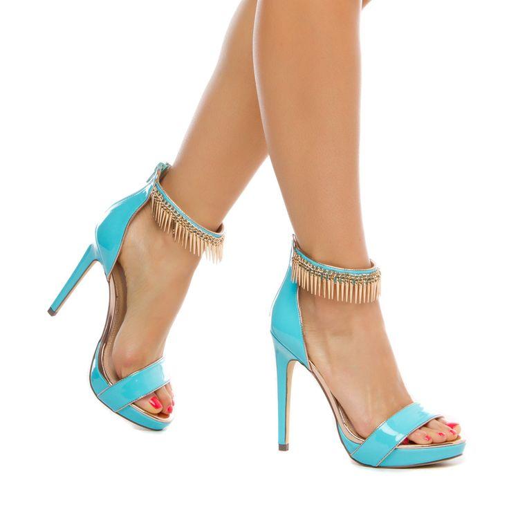 Sassy heels, love the bit of fringe around the ankle strap.