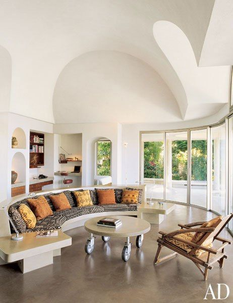 Liz Claiborne's St. Bart's home. The concrete sofa and wood armchair feature cushions of African mud cloth.