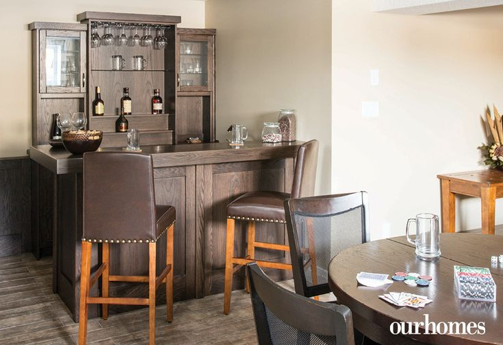 A basement bar sets the tone for a great entertaining space. - Via OUR HOMES Wellington Spring 2016.  http://www.ourhomes.ca/articles/build/article/the-rain-and-the-sun-power-this-gorgeous-elora-home