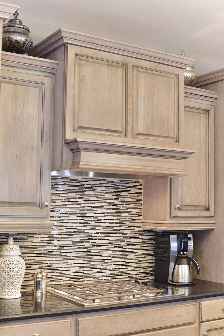 This Backsplash Balances Out The Cabinetry Design
