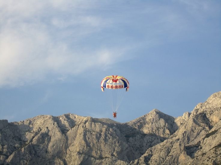 Parasailing on Makarska. In the background Biokovo mountain.