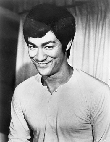 Bruce Lee That beautiful wicked smile! Handsome.