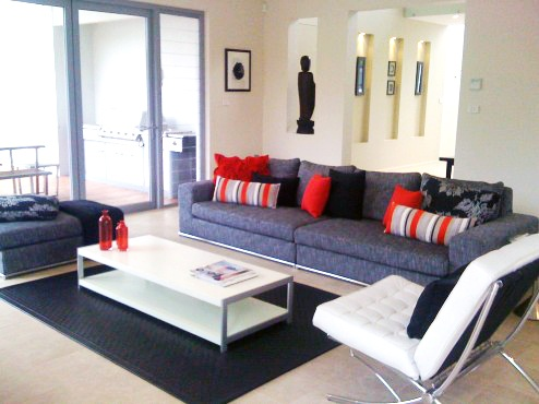Classic grey and white styling with highlights of red complete this modern lounge room. The Point, Bella Vista
