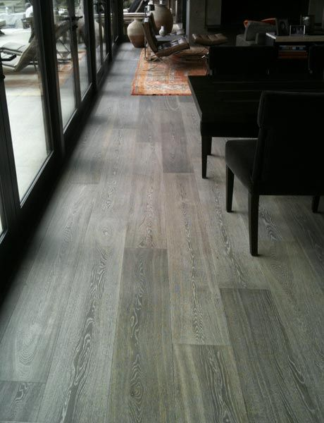 Our custom Aged French Oak floors are extremely popular with interior designers. The unique aging process renders stunning results with the look and patina of genuine antique French oak floors.  Exquisite Surfaces - Flemish Gray - Manoir Collection