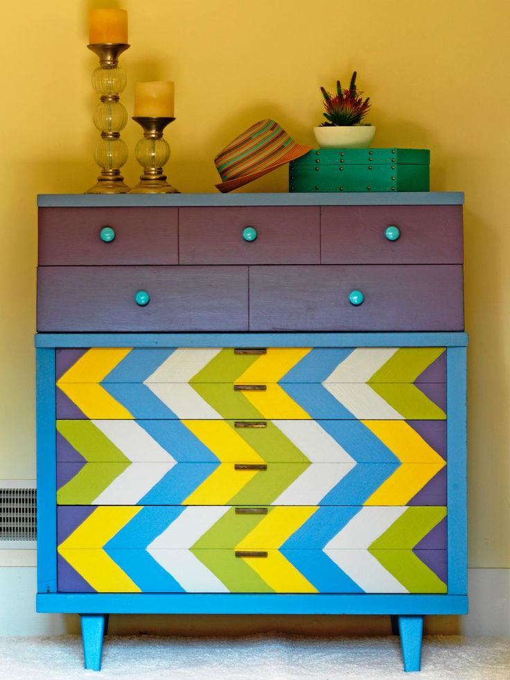 A thrift-store dresser was given new life with freshly painted arrow-pattern drawers and a cheery color palette.