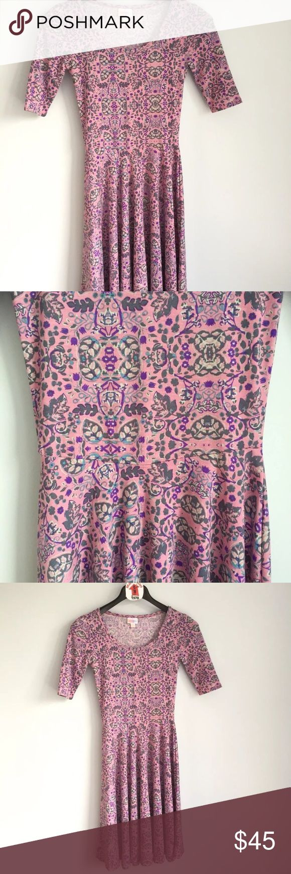 """LuLaRoe Nicole Dress Lilac Purple Floral Women's LuLaRoe LLR Nicole Dress  Lilac Purple Floral Print   Short Sleeve  Fitted Bodice A-line Skirt  Knee Length  New with out tags  Size XXS  Measures 14"""" across chest arm pit to arm pit laying flat  Length is 41"""" long from top of shoulder to bottom front hem LuLaRoe Dresses"""