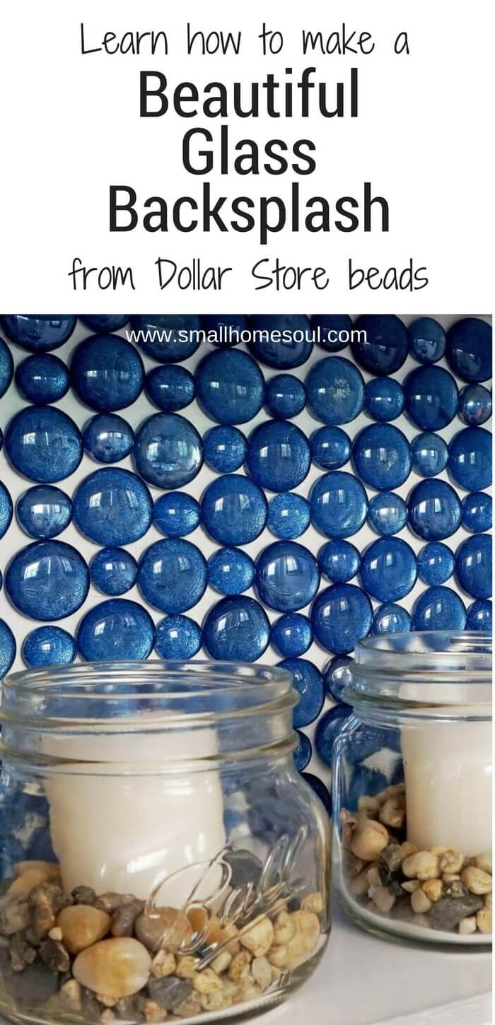 Learn how to make this beautiful glass backsplash for your bathroom or kitchen using glass Dollar Store beads and spray paint.