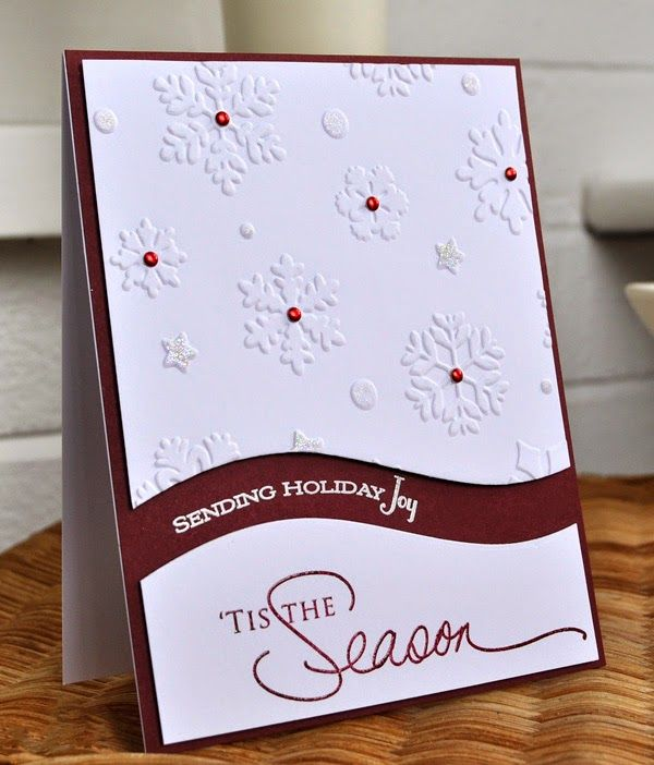 handmade Christmas card from Inky Fingers ... brown and white ... luv how she split the main panel along a curvy line leaving enough room to stamp part of the sentiment ... embossing folder snowflakes on the top panel ... big sentiment on the botttom panel ... like it!