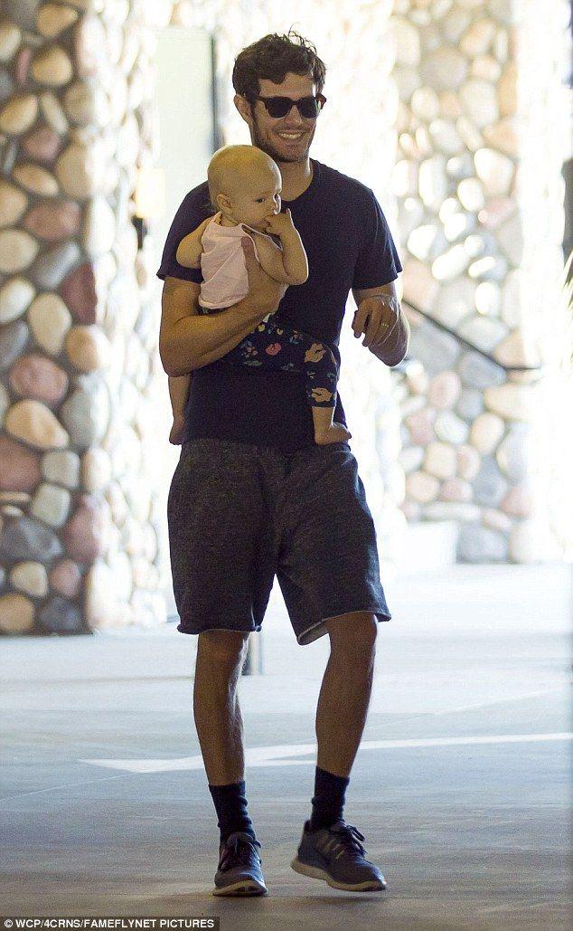 Adam Brody beams with pride as he carries one-year-old daughter Arlo