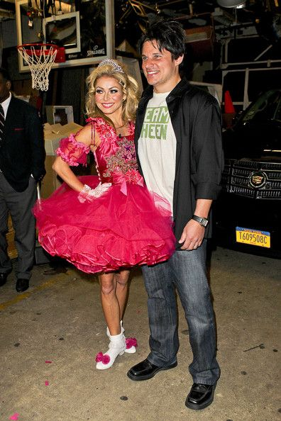 "Kelly Ripa Photos Photos - Kelly Ripa and Nick Lachey show off their Halloween costumes after a taping of ""Live with Regis & Kelly"". Ripa was dressed up as a pageant princess, wearing a pink frilly dress and tiara, while Lachey was dressed as Charlie Sheen, complete with wig and 'Team Sheen' t-shirt. - Kelly Ripa and Nick Lachey in Costume 2"