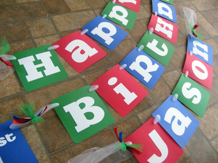 Happy Birthday banner in red, green and blue. Created by Banana Lala Party Designs & More