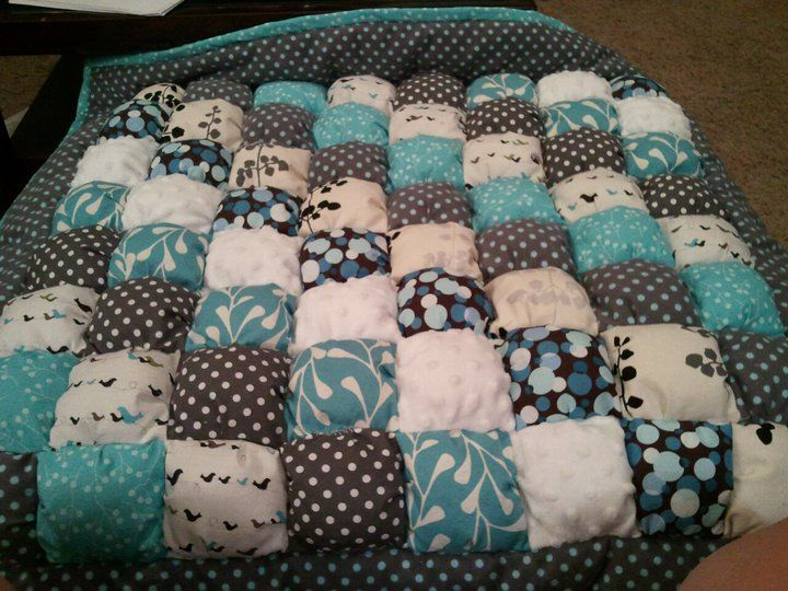 How to Make a Biscuit Quilt.  Top square is 1-1.5 inches bigger than bottom square.  See 3 sides, stuff join with quarter inch seam and attach to backing. Add borders.