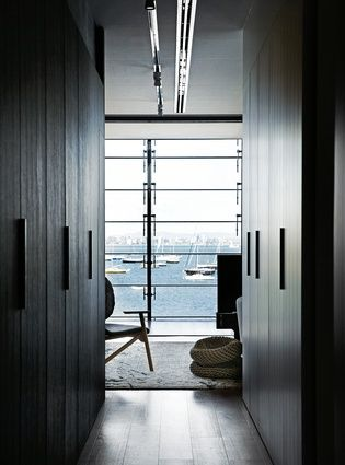 An interior balcony with louvred glazing has views out across the bay.