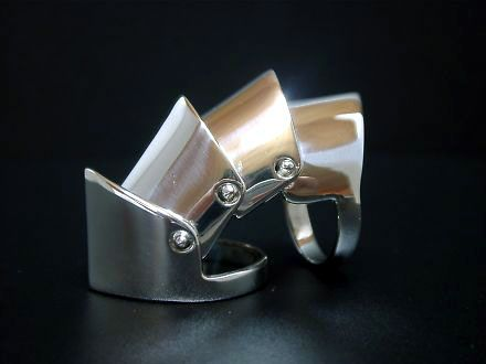 Stirling silver finger armor ring.
