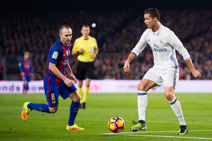 Cristiano Ronaldo of Real Madrid CF controls the ball next to Andres Iniesta of FC Barcelona during the La Liga match between FC Barcelona and Real Madrid CF at Camp Nou stadium on December 3, 2016 in Barcelona, Spain. (Dec. 2, 2016 - Source: Alex Caparros/Getty Images Europe)