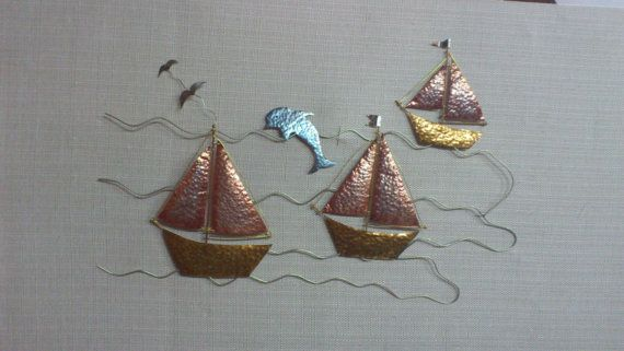 three sailboats travelling with a dolphin in a by MetalCraftStudio