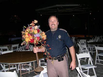 Jeremy Deller Cop with Flowers, San Antonio, Texas  2003. Won 2004