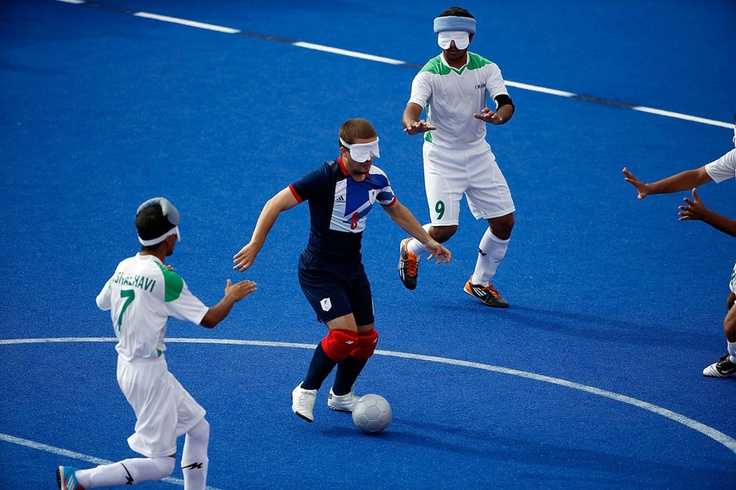 2012 Summer Paralympics - Lee Brunton of Great Britain takes on the Iranian defense in the Men's Team Football 5-a-side B1 (visual impairment) in the Olympic Park on September 4, 2012. All athletes wear eyeshades to ensure their visual impairments are equal. The ball is equipped with a noise-making device, and each team has a sighted, able-bodied goalkeeper. (Matthew Lloyd/Getty Images)