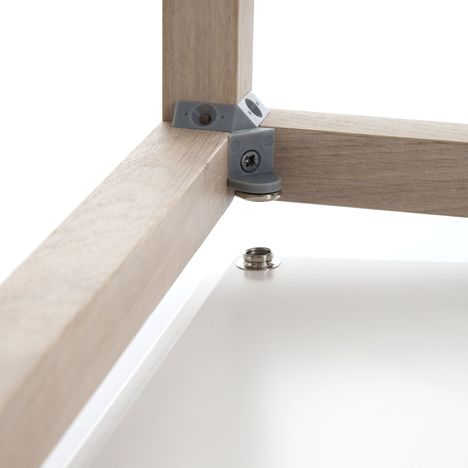 The ADD System comprises timber batons joined with plastic connectors hidden on the inside of the frame. Side, front and back panels can then be simply clipped to the plastic components with metal fastenings - ADD System Furniture by Werner Aisslinger for Flötotto