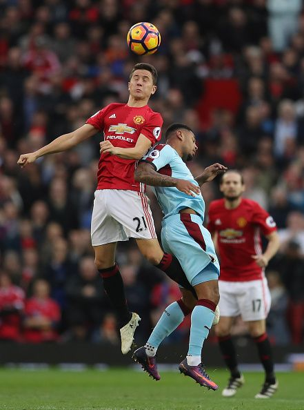 Ander Herrera of Manchester United and Andre Gray of Burnley compete for the ball during the Premier League match between Manchester United and...