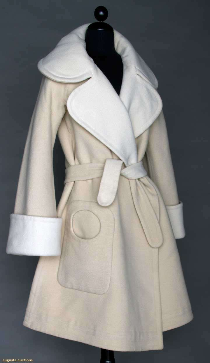 "Pierre Cardin Couture Coat, 1970, Augusta Auctions -- Cream wool reversing to white wool, open front swing coat, large collar, raglan sleeve, single patch pocket w/ circular opening, optional tie belt, label ""Pierre Cardin Paris"", L 39"", excellent. Provenance: Mme. Erna de Paz, Argentine & Parisienne socialite & friend of Msr. Cardin."