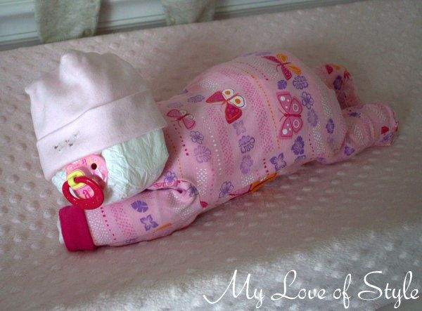 DIY Sleeping Baby Diaper Cake: Tutorial ~ This would make a wonderful Christmas gift for someone who is expecting.