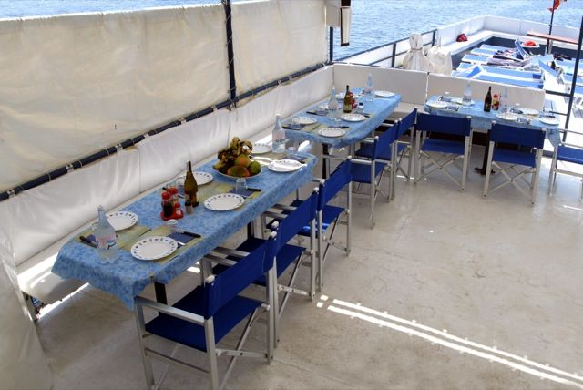 Having lunch and dinner together (italian cook on board!) on the deck.