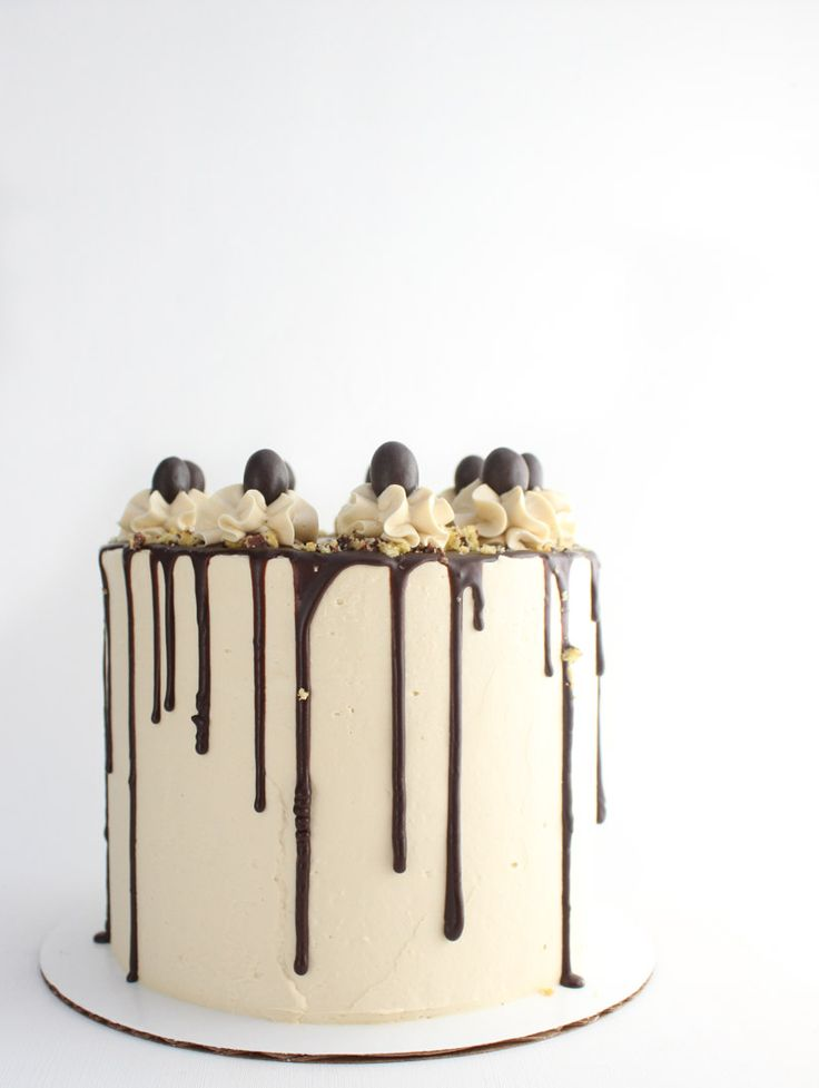 This decadent chocolate and vanilla bean cake with encased with espresso frosting and filled with bits of cookie is the ultimate cake for the coffee lover in your life!