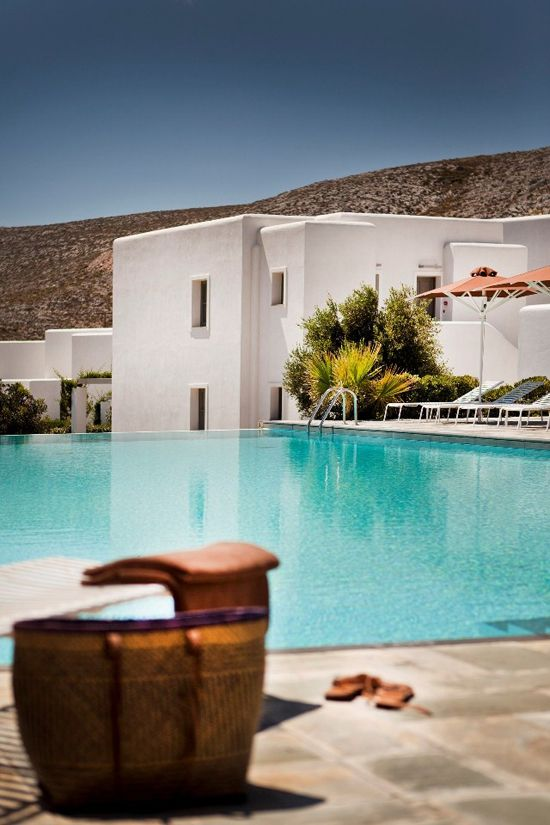 -folegandros- Snapshots of the tranquil pool of Anemi Hotel and the harsh cliffs to the sea dressed in a golden sunsetting light, both in Folegandros island in souther Aegean.