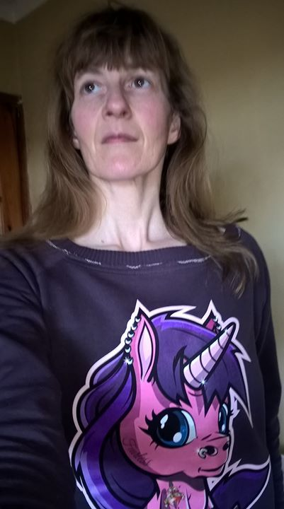 Trying to look badass wearing my Fearless the unicorn top...and failing miserably!!  :-P