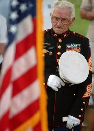 Retired 1st Marine Division Gunnery Sgt. Tom Mazzarella, of Norwich, pays his respects to the American flag during a Flag Day ceremony at Davis Park in Danielson. Mazzarella served 23 years in the Marine Corps through World War II and Korea. He passed away on July 30, 2012 at the age of 91.