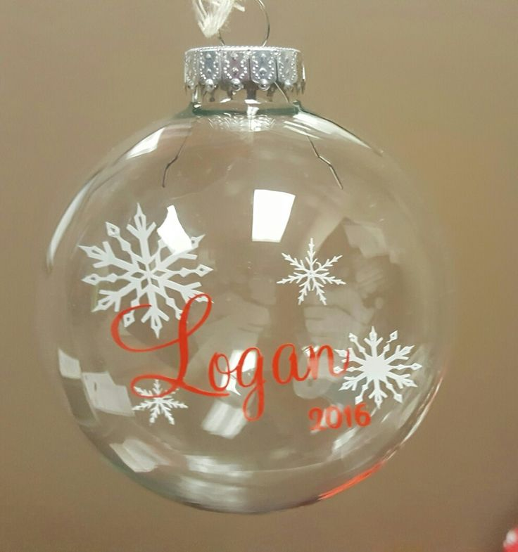 My DIY glass bauble/ornament.  I made this for a coworker and her new-born son.  I etched baby feet on the back and used vinyl and transparent paper for a floating effect.  I love how it turned out.